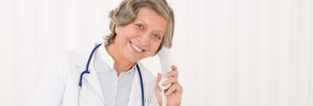 doctor holding a telephone